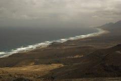 Playa en tiempo opaco Fotos de archivo libres de regalías