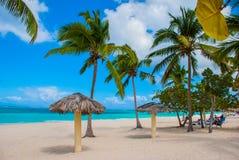 Playa Esmeralda, Holguin, Cuba. Caribbean sea. Beautiful Paradise beach: umbrellas, sea, palm trees, sand. Playa Esmeralda in Holguin, Cuba. Caribbean sea royalty free stock image