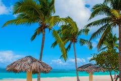Playa Esmeralda, Holguin, Cuba. Caribbean sea. Beautiful Paradise beach: umbrellas, sea, palm trees, sand. Playa Esmeralda in Holguin, Cuba. Caribbean sea stock image