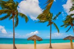 Playa Esmeralda, Holguin, Cuba. Caribbean sea. Beautiful Paradise beach: umbrellas, sea, palm trees, sand. Playa Esmeralda in Holguin, Cuba. Caribbean sea royalty free stock photo