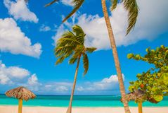 Playa Esmeralda, Holguin, Cuba. Caribbean sea. Beautiful Paradise beach: umbrellas, sea, palm trees, sand. Playa Esmeralda in Holguin, Cuba. Caribbean sea stock photography