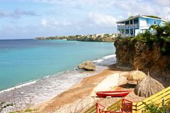 Playa Forti, Curacao. A blue house sits precariously on a cliff overlooking the beach at Playa Forti, Curacao royalty free stock image