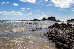 Playa Grande, Costa Rica. Relaxing beach scene in Playa Grande Costa Rica with waves crashing into the rocks with crystal clear water stock photo