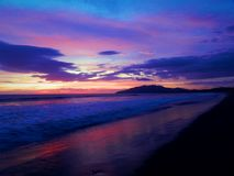 Playa Grande`s Sunset. Landscape from Playa Grande, Tamarindo, Costa Rica; a surfer beach with beautiful sunsets,  like this one. There you can see  animals Stock Images
