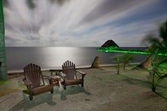 Playa iluminada por la luna fotos de archivo