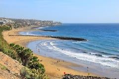 Playa Ingles, Gran Canaria. Playa Ingles beach overview in Gran Canaria. Atlantic Ocean breakwater structures royalty free stock image
