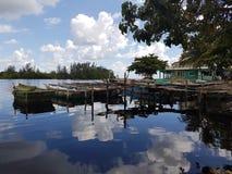 Playa Larga, Bahía de Cochinos, Cuba. Pigs Bay, Bahia de Cochinos, boats, clouds reflecting in the sea Royalty Free Stock Photography