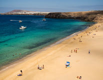 Playa Mujeres, Lanzarote, Canary Islands, Spain. Holidaymakers on the golden sands of Mujeres Beach in Lanzarote, Canary Islands, Spain Stock Image