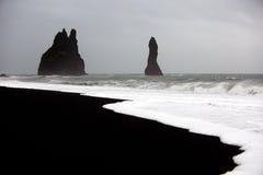 Playa negra de la arena Imágenes de archivo libres de regalías