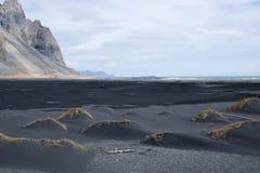 Playa negra de la arena Foto de archivo libre de regalías
