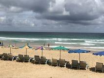 Playa nublada Fotos de archivo libres de regalías