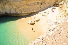 Playa ocultada por el mar Foto de archivo