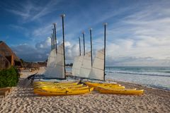Colorful sail catamarans on the beach at Caribbean Sea of Mexico. Playa Paraiso, Mexico - February 4, 2018: Colorful sail catamarans on the beach at Caribbean Royalty Free Stock Photos