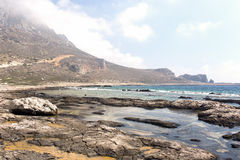 Playa pedregosa salvaje Fotos de archivo