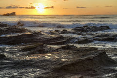 Playa Pelada Sunset on Waves of Rock Royalty Free Stock Image