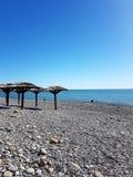 Playa por el mar Imagen de archivo libre de regalías