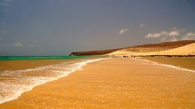Playa Sotavento - virgin, wild beach in Fuerteventura, Canary Islands, Spain. Sotavento is the Fuerteventura best known beach. Playa Sotavento is windsurfing stock photography