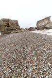 Playa texturizada piedra del guijarro Imagen de archivo