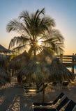 Playa tropical de la puesta del sol Foto de archivo libre de regalías