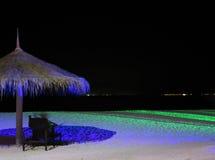 Playa tropical en la noche Foto de archivo libre de regalías