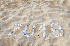 Playa tropical y 2018 Felices Año Nuevo Foto de archivo libre de regalías