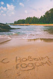 Playa tropical y Feliz Año Nuevo Imagenes de archivo