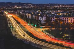 Playa Vista Traffic. Long-exposure light streaks of traffic at dusk over a busy road in Playa Vista, California Royalty Free Stock Photography