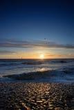 Playa viva del holandés de la puesta del sol Fotografía de archivo