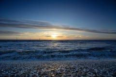 Playa viva del holandés de la puesta del sol Foto de archivo