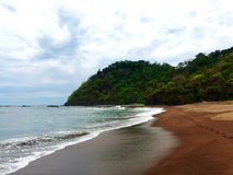 Playa volcánica de Jaco Imágenes de archivo libres de regalías