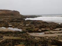 Playa y agua de la roca Foto de archivo libre de regalías