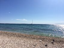Playa y barco Imagen de archivo libre de regalías