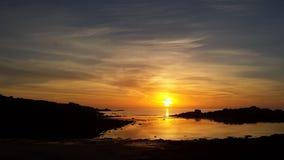 Playa y cielo de la puesta del sol Fotografía de archivo