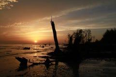 Playa y cielo de la puesta del sol Foto de archivo