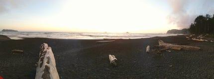 Playa y cielo de la puesta del sol Imagen de archivo libre de regalías