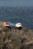 Playa y libro Imagenes de archivo
