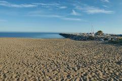 Playa y muelle de Marbella Imagenes de archivo