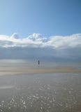 Playa y nubes Fotos de archivo