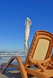 Playa y silla Foto de archivo libre de regalías