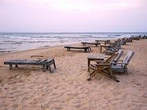 Playa y sillas Foto de archivo libre de regalías