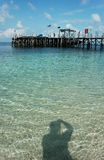 Playa y sombra Foto de archivo