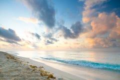 Playacar strand på soluppgången Arkivbild