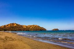 Beautiful Playas del Coco with Coastal Mountain in Background. Playas del Coco situated on the Pacific Ocean in Costa Rica royalty free stock photography