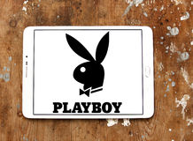 Playboy logo. Logo of Playboy magazine on samsung tablet on wooden background. Playboy is an American men`s lifestyle and entertainment magazine Stock Photos