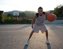 Player. Photo of a basketball player on a outdoor court Stock Photo