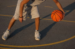 Player. Photo of a basketball player on a outdoor court Royalty Free Stock Photography