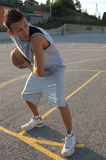 Player. Photo of a basketball player on a outdoor court Royalty Free Stock Photos