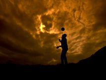 The Player. Football player on orange cloudy sunset stock photography