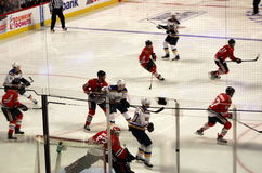 Player Action at Chicago Blackhawks Hockey Game. Players compete at a game between the Chicago Blackhawks and the St. Louis Blues hockey teams at the United stock photos