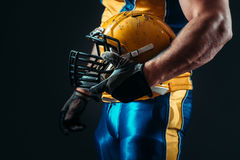 Player with american football helmet in hand Stock Photos